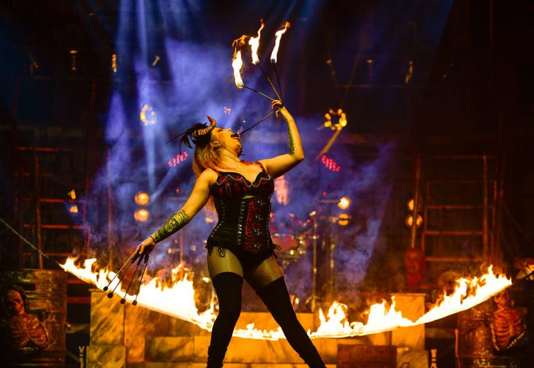 Fire eating woman